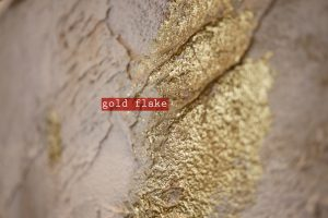 kricket-soho-london-bar-restaurant-design-interiors-gold-flake-wall-bespoke-caption