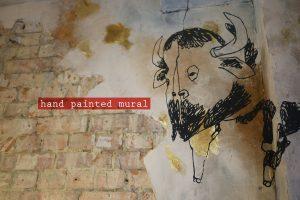 kricket-soho-london-interior-design-wall-decals-bespoke-hand-painted-caption