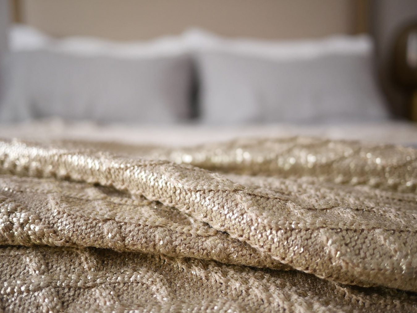 interior-design-styling-residential-luxury-bed-throw-golden-pillows-material-textures