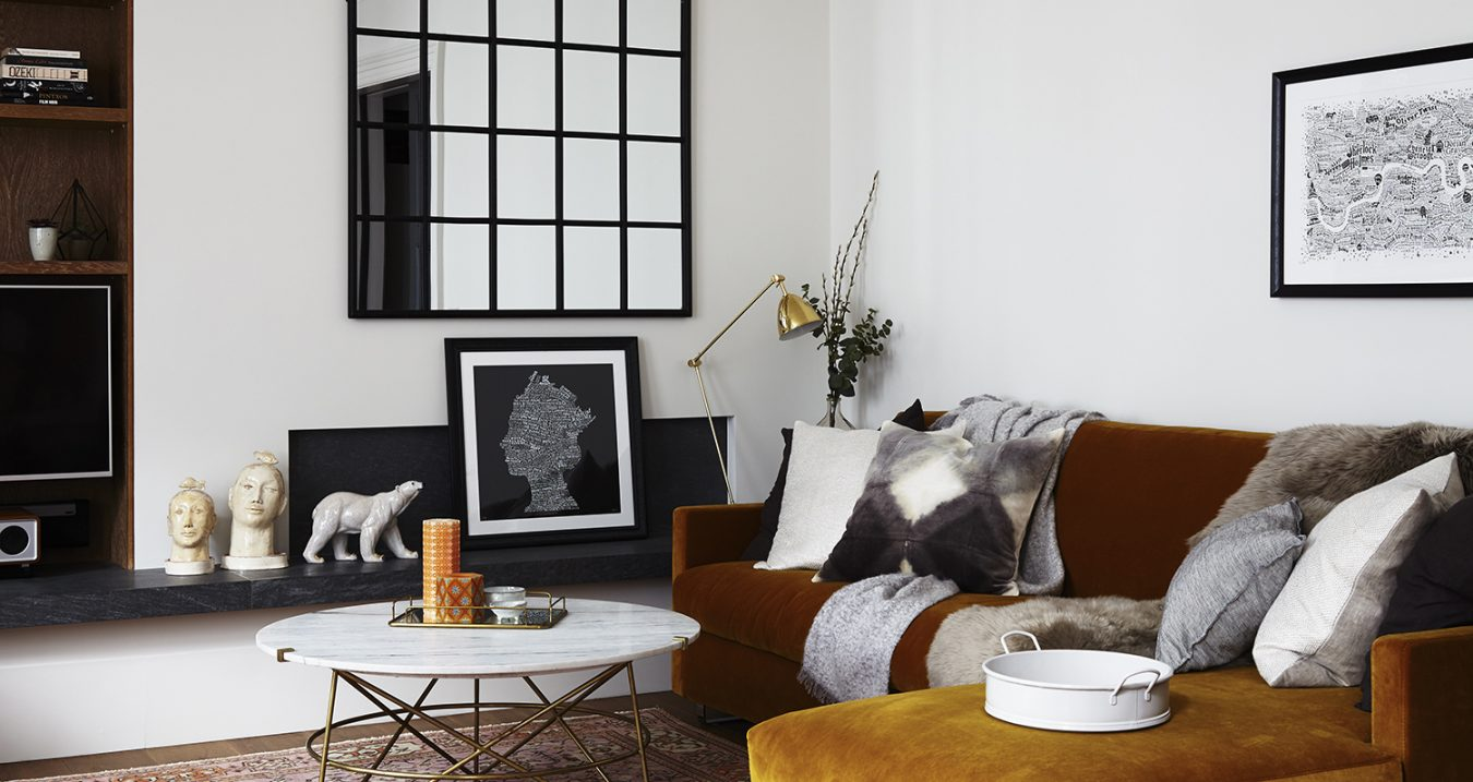 interior-design-styling-residential-luxury-sofa-cushions-mirror-livingarea-runforthehills-artwork-prints-cropped