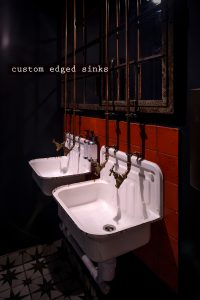 kricket-soho-london-bar-restaurant-design-interiors-bathroom-toilets-sinks-custom-caption