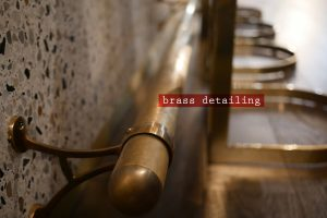 kricket-soho-london-bar-restaurant-design-interiors-brass-detailing-caption