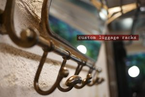 kricket-soho-london-bar-restaurant-design-interiors-custom-luggage-racks-caption