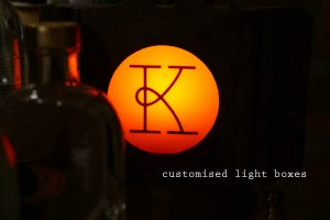 kricket-soho-london-bar-restaurant-design-interiors-lighting-custom-caption