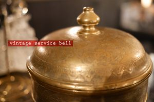 kricket-soho-london-bar-restaurant-design-interiors-vintage-service-bell-caption